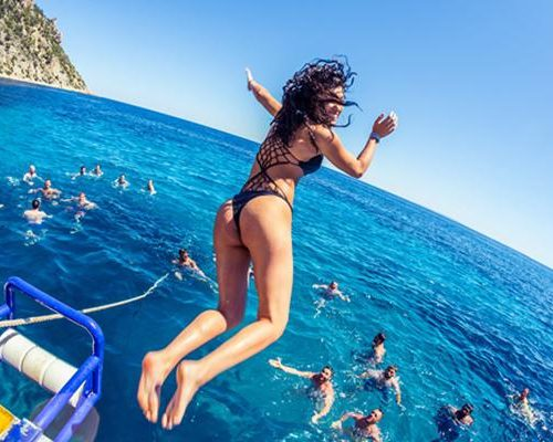 girl-jumping-boat-party-ibiza