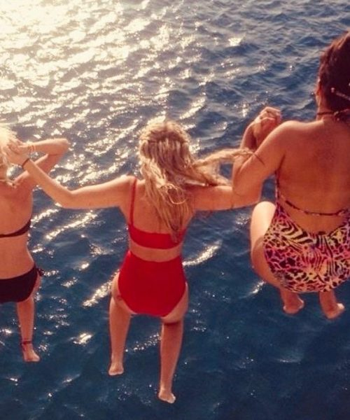 girls-jumping-from-boat-party-in-tenerife