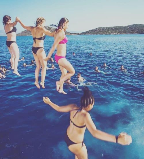 group-of-girls-jumping-on-the-malia-booze-cruise