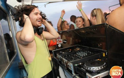dj smiling on boat party ibiza