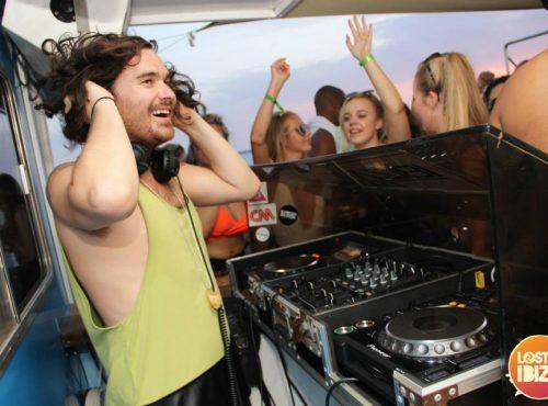 dj smiling on boat party ibiza
